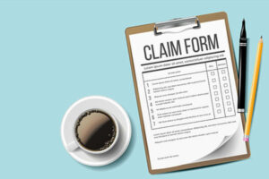 Workers compensation claim form sitting on a desk