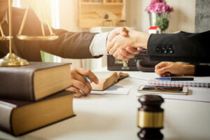 A lawyer and insurance adjuster agree on a workers compensation settlement