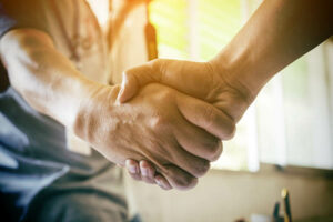 A handshake deal being made during workers comp mediation